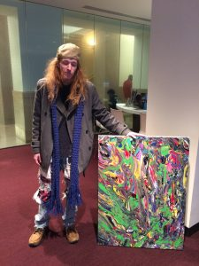 """Jacob holding a colorful abstract painting, acrylic on canvass 30""""x40"""""""